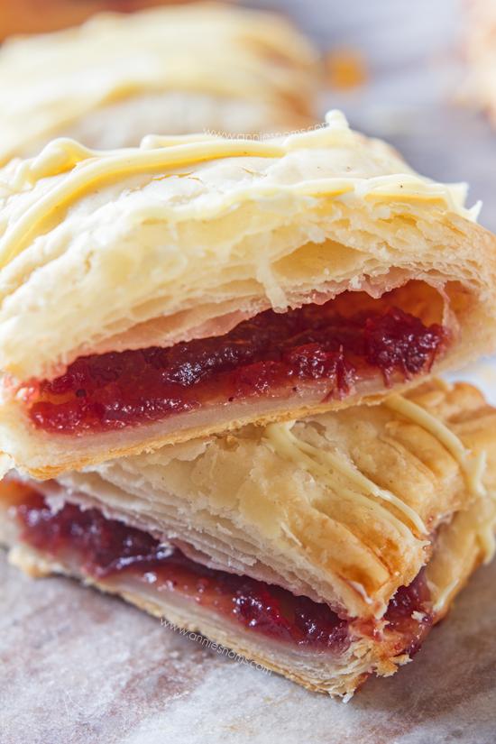 Cranberry and Orange Hand Pies - Festive hand pies filled with cranberry and orange and drizzled with white chocolate.
