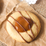 These thumbprint cookies marry crisp, buttery cookie dough, sweet, rich dulce de leche and melted chocolate to create tiny little bites of heaven!