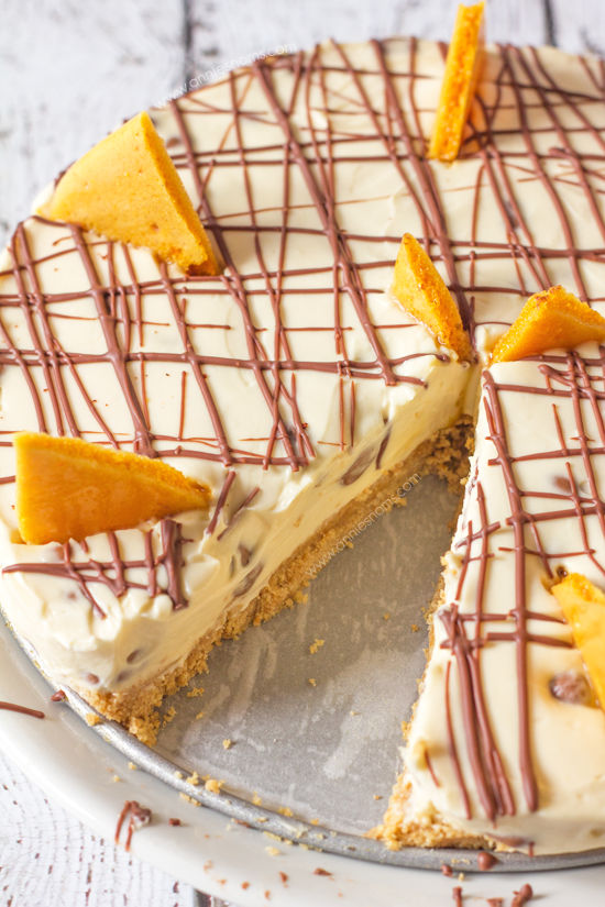 This no-bake Chocolate Honeycomb Cheesecake is packed with tiny morsels of crunchy honeycomb inside a velvety smooth cheesecake. With a simple biscuit base and homemade honeycomb garnish, this dessert is a showstopper that doesn't take hours to make!