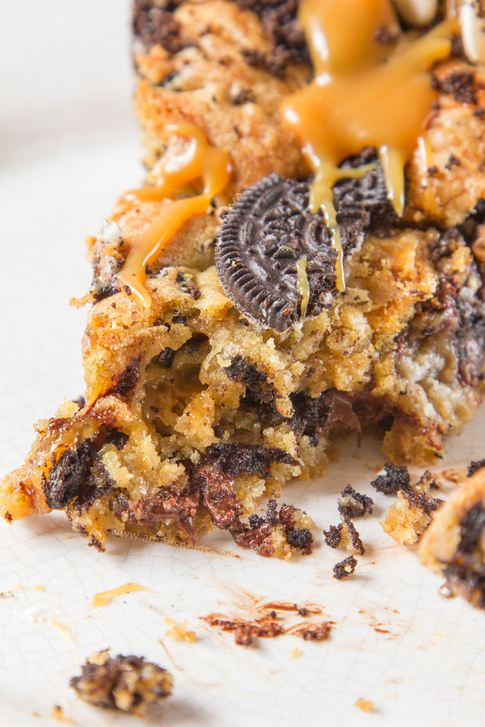 Oreo and chocolate chip stuffed cookie dough with an oozing middle of salted caramel sauce and a topping of more cookie dough and Oreo's. Bake it up and you will have a gooey, golden, rich, sweet and salty dessert which tastes like pure heaven.