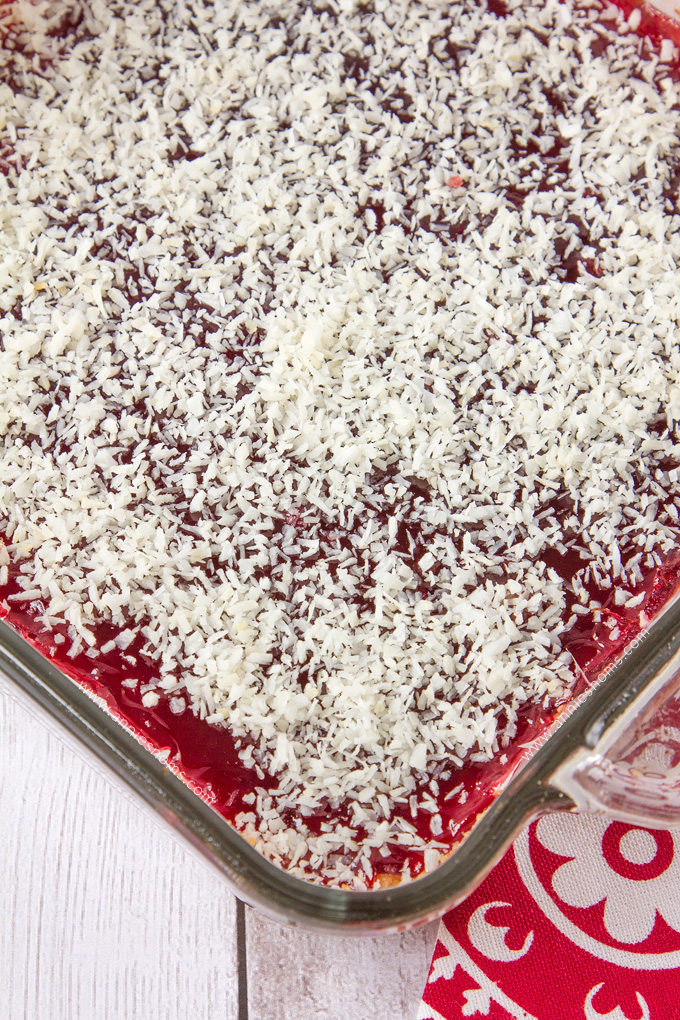 These Raspberry Coconut Bars are super simple to make and with their shortbread base, raspberry jam middle and desiccated coconut topping, they are a combination of sweet, crunchy and tart in one portable dessert!