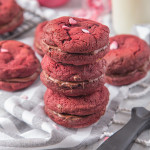 Soft, chewy Chocolate Chip filled Red Velvet Cookies sandwiched together with creamy, smooth chocolate spread to make a cute and delicious Valentine's treat!