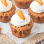 These Carrot Cupcakes are spicy, sweet, jam packed with shredded carrot and topped with a smooth, fluffy Marshmallow Frosting.