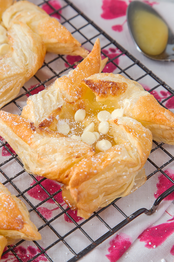 These gorgeous Lemon Curd and White Chocolate Pinwheel Pastries are ready in under 30 minutes and only require 4 ingredients!