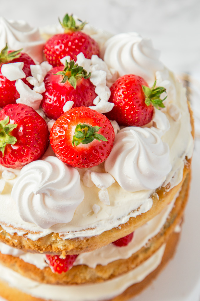 Layers of cake, cream, strawberries and meringue are married together to create this over the top, simply delicious Eton Mess Cake! #ad