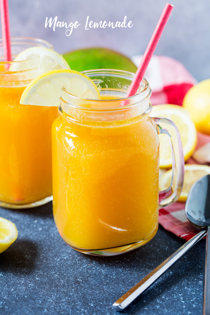 This refreshing Mango Lemonade is the perfect tropical beverage to help you cool down on a hot Summer's day. Sweet and tart, it's also super easy to make!