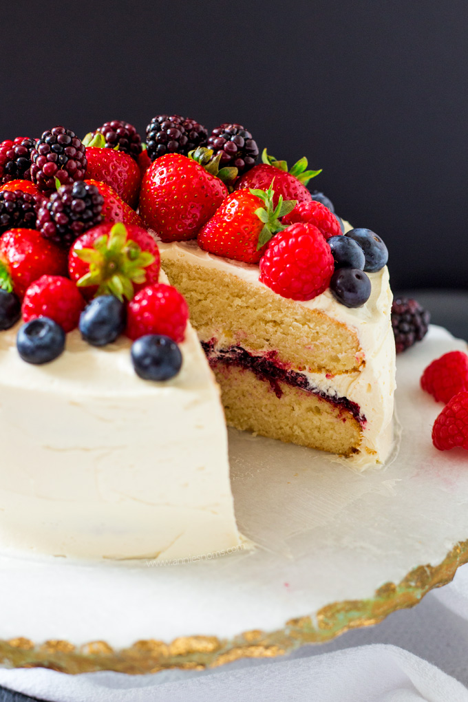 This Summer Berry Layer Cake is the ultimate cake for the berry lovers in your life with layers of vanilla cake, homemade berry jam and a myriad of fresh berries on top.