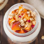 These Peach Parfaits are made with creamy Greek yoghurt, sweet peaches and crunchy granola; light and tasty, you decide whether these are breakfast or dessert!
