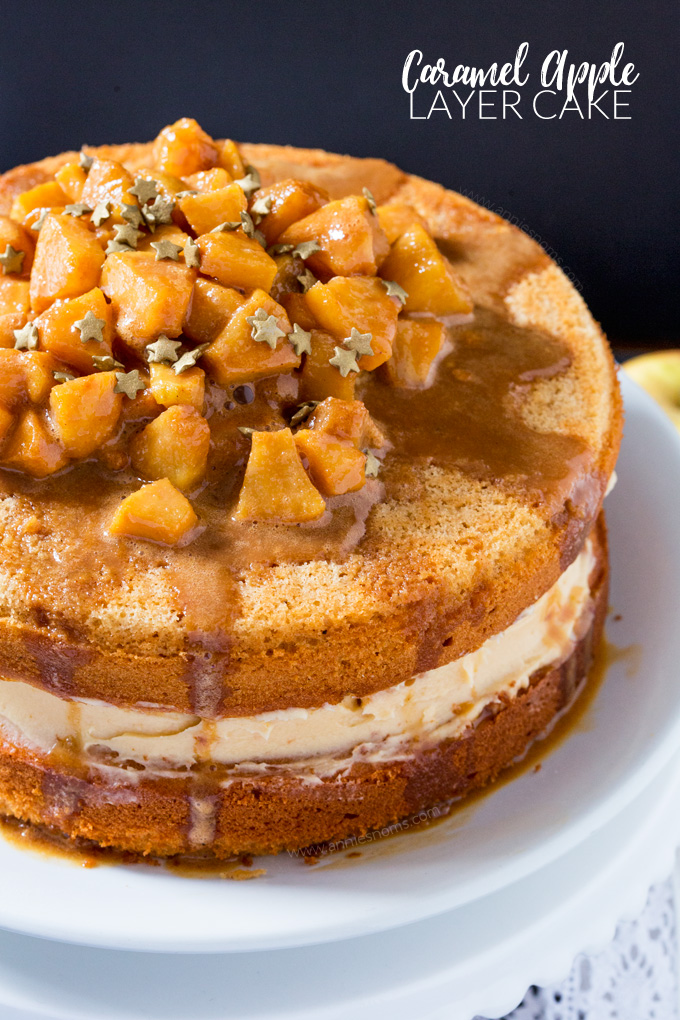 This Caramel Apple Layer Cake is Autumn in cake form! A lightly spiced cake, with sweet frosting and caramel apples piled high on top; this is one seriously delicious and easy to make showstopper!