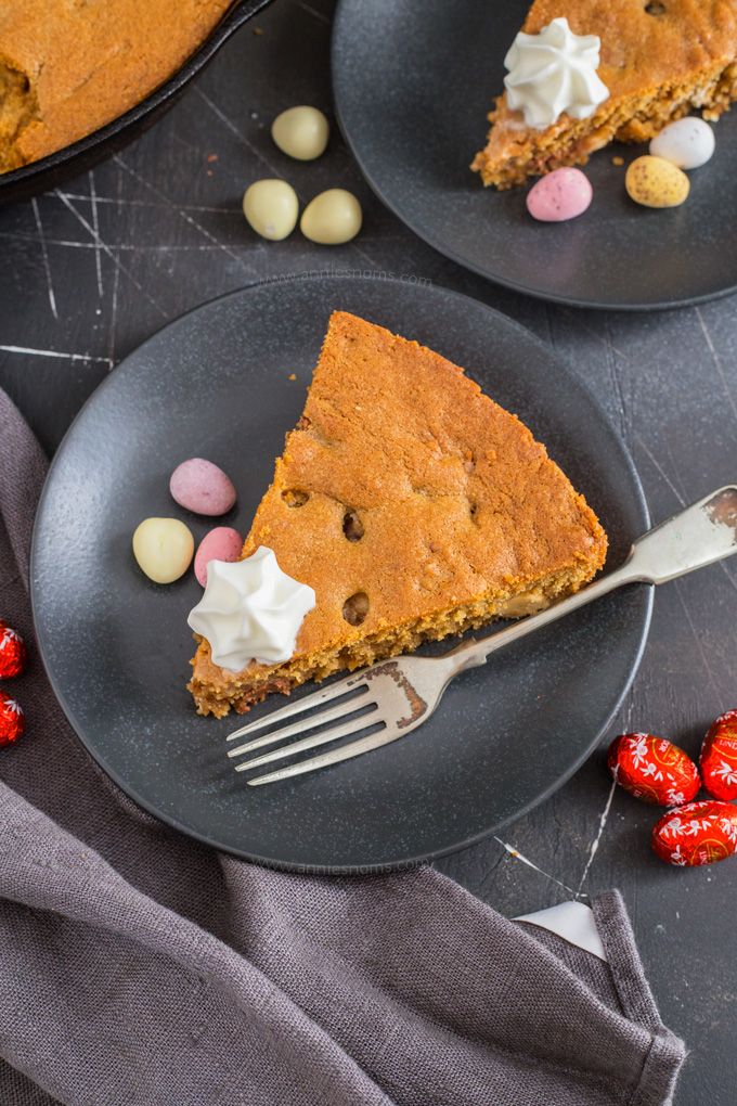This Easter Skillet Cookie is soft, chewy and perfect for sharing! It's filled with Milkybar mini eggs, Cadbury mini eggs and Lindor Mini eggs and is a melty, chocolatey sensation! Grab your spoons and dig in!