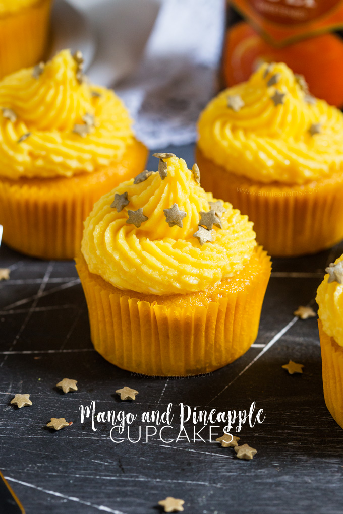 These soft Mango Cupcakes are filled with crushed pineapple and topped with a light and fluffy mango frosting. A delicious tropical cupcake perfect for the warmer weather!