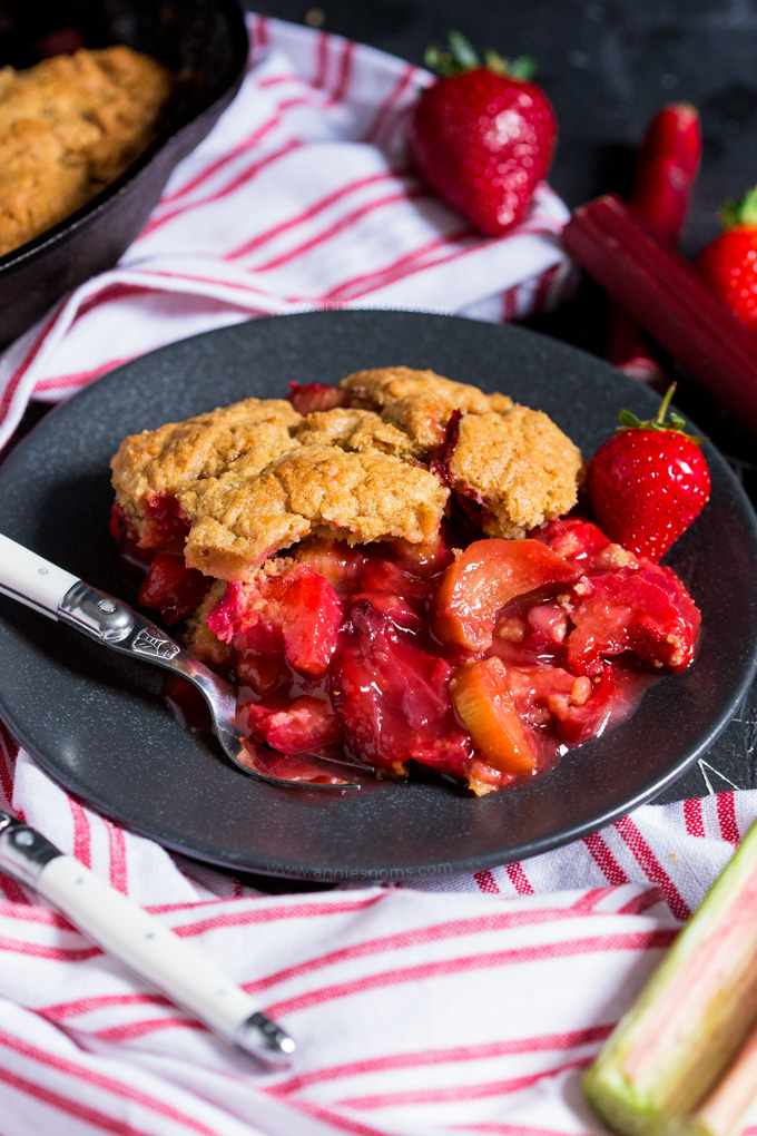 Sweet strawberries and tart rhubarb are married together with a crisp, yet fluffy top to make this sublime cobbler which you'll make again and again!