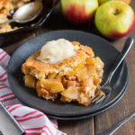 This Apple Pie Skillet Cobbler is a hybrid of two fantastic desserts! An apple pie filling is baked in a skillet with a crumbly cobbler topping to create one seriously epic and tasty dessert!