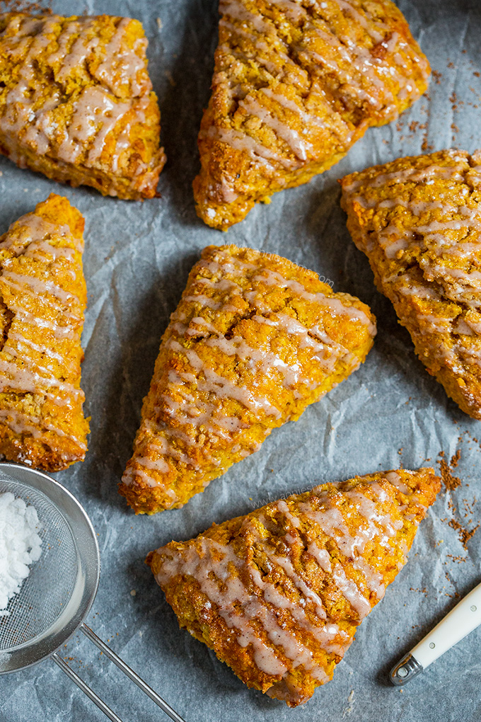 These flaky and buttery Pumpkin Scones are drizzled with a spiced glaze to make one seriously awesome breakfast that will start your day on the right foot!