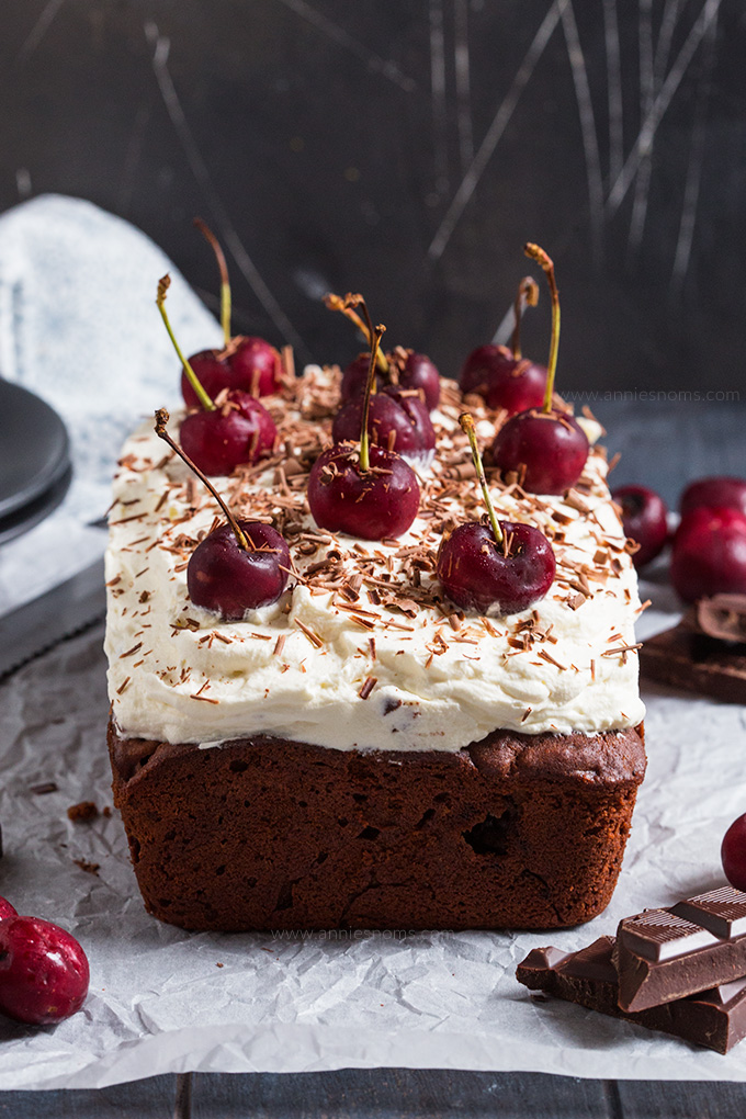 This Black Forest Loaf Cake can be made with or without alcohol and makes the perfect centrepiece for your holiday table! A rich chocolate cake with cherries and cream, it's easy to make and delicious!