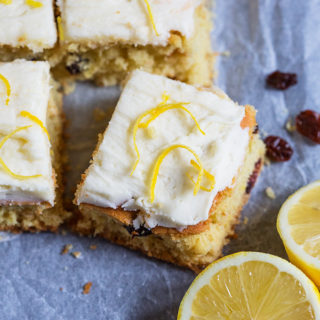 These light and soft Lemon and Cranberry Cake Bars are filled with lemon zest and juicy cranberries. They are simple to make and feed a crowd!
