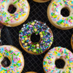 These baked doughnuts require only cake mix and three other ingredients to make! They're light and fluffy and you can dip in any flavour glaze you like!