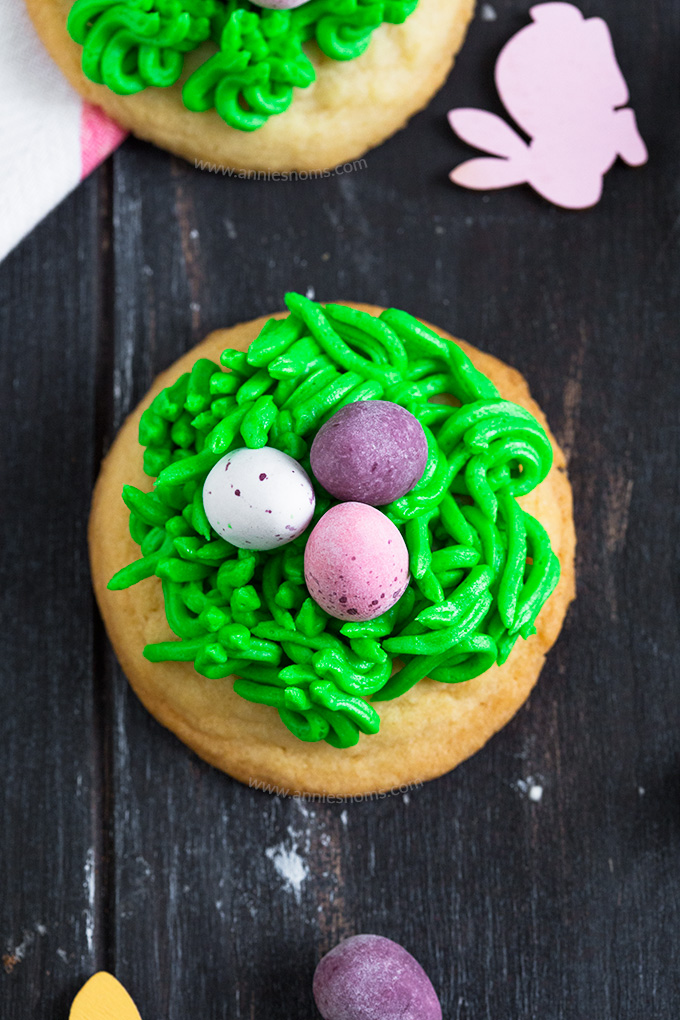 These drop sugar cookies are quick to make and decorated with buttercream and mini eggs to make them look like nests. Fun for kids and adults alike this Easter!