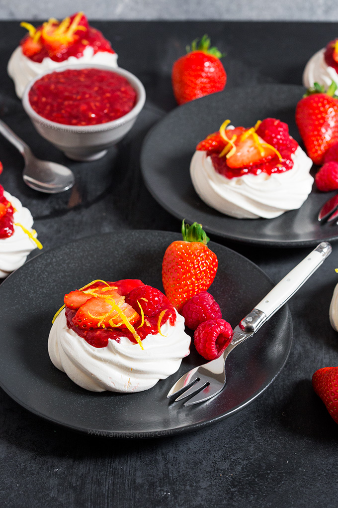 These Meringue Nests with Homemade Berry Jam marry together crunchy, sweet meringue, whipped cream, homemade jam and fresh fruit to make a delicious dessert!