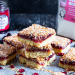 These Cranberry Coconut Bars combine a buttery shortbread base, cranberry sauce and toasted coconut to make a festive, delicious treat!