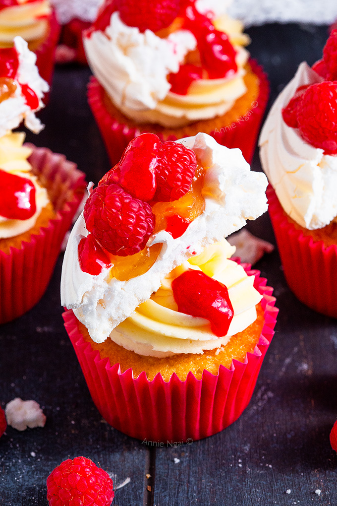 These Lemon and Raspberry Pavlova Cupcakes marry together soft, fluffy lemon cupcakes with lemon curd, frosting, meringue, raspberries AND raspberry sauce to create one seriously divine cupcake!