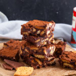 This Chocolate Fridge Cake is kid friendly and so delicious. It uses up biscuits, dried fruit, milk and dark chocolate and can be thrown together in minutes!