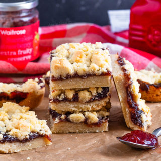 These Strawberry Jam Crumble Bars are buttery, crisp, sweet and full of oozing jam. You don't need any fancy ingredients or equipment to make these and they're easy to throw together!
