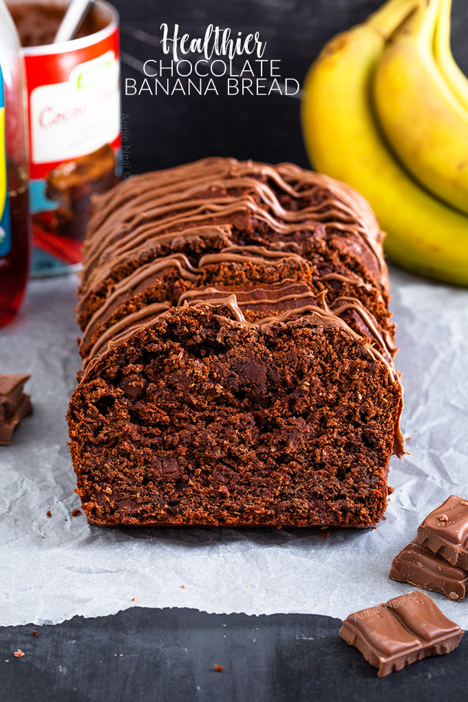 This Healthier Chocolate Banana Bread is made with whole wheat flour, agave, coconut oil and plenty of bananas. It's peppered with dark chocolate chips to create a healthier, but still delicious bread!