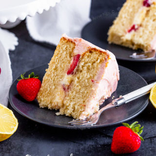This Strawberry Lemon Layer Cake marries together a lemon cake, lemon curd filling, fresh strawberries and jam buttercream to make one seriously delicious layer cake!