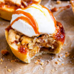 These Mini Toffee Apple Crumble Pies make pie making easy! Made in a muffin tin with buttery pastry, tender apples, toffee sauce and a buttery crumble topping. They are Autumn in dessert form!