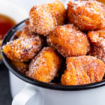 These Pumpkin Churro French Toast Bites are tiny bites of pure heaven. Rolled in pumpkin, and cinnamon sugar, you will love dipping these French Toast Bites into chocolate or maple syrup!