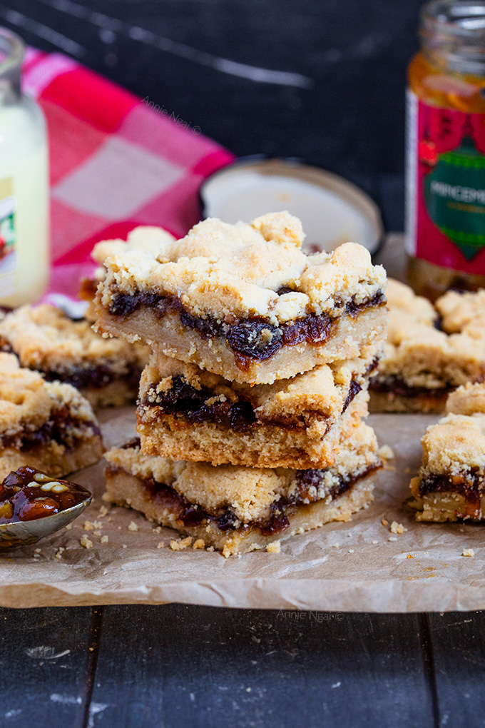 These Mincemeat Shortbread Bars are just as tasty as Mince Pies, but a cinch to make! Buttery shortbread and sweet mincemeat baked together until golden. Simple, yet divine!