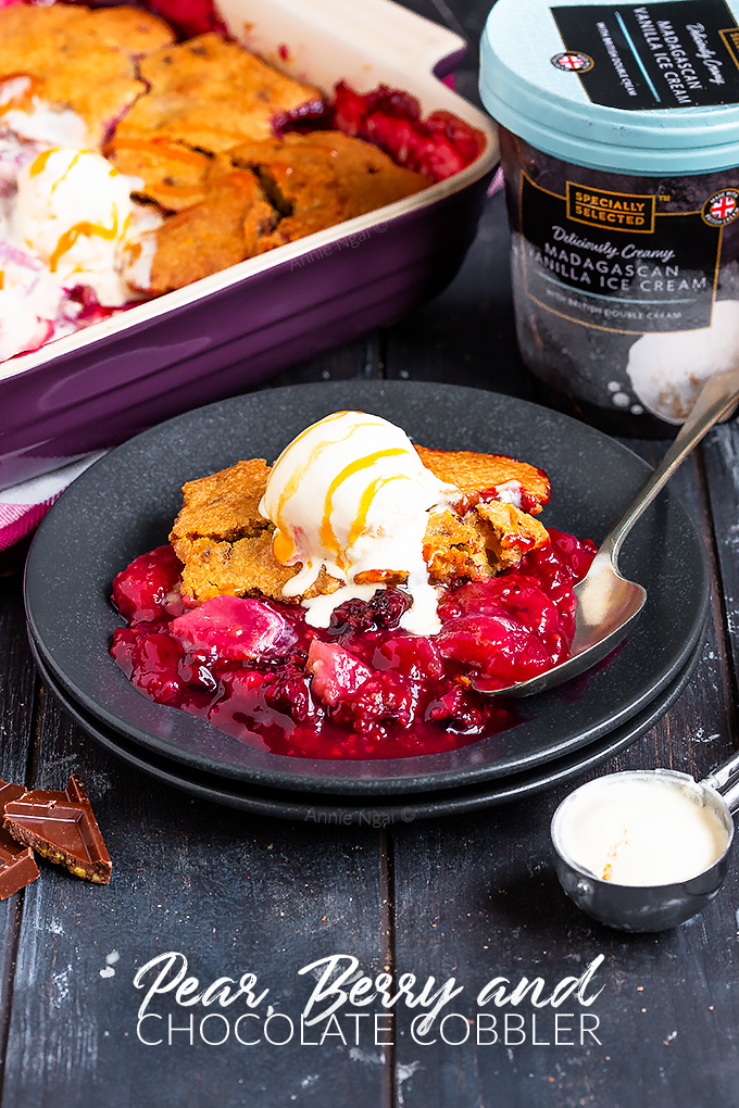 This Pear, Berry and Chocolate Cobbler is one of the tastiest desserts I've ever made. Tart, sweet, fruit filled and peppered with chocolate chunks, it's also super simple to make!