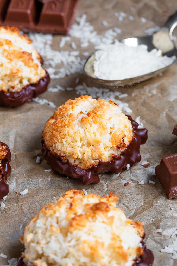 These Coconut Macaroons are ridiculously easy to make and only need a few ingredients! Baked until golden and dipped in chocolate, they're the perfect bitesize treat!