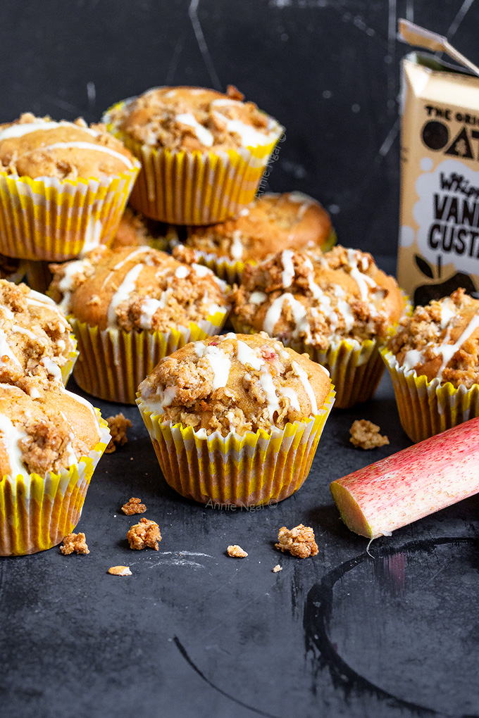 These Rhubarb and Custard Crumble Muffins are packed full of seasonal rhubarb, custard in the batter and finished off with an oaty streusel topping.