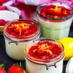This Lemon Posset with Strawberry Sauce is the perfect easy to make Summer dessert! Light, full of flavour and topped with a homemade sauce, this will become a staple dessert!